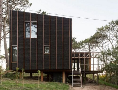 A stilt house in Uruguay made of different types of wood